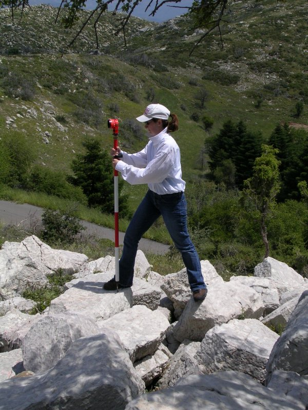 Fig. 4: Jennifer Gates using survey reflector.