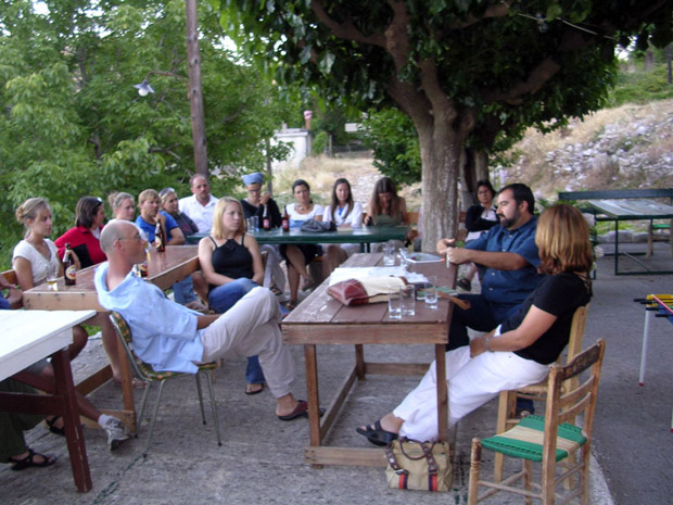 Fig. 11: Professor Yanis Pikoulas giving a lecture in the village plateia.