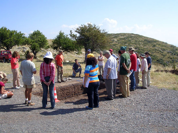 Fig. 17: Trench talks at Trench A. Allisa Stoimenoff, center, speaking.