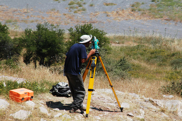 Fig. 4: Andrew Insua operating the total station on a rise above the hippodrome.