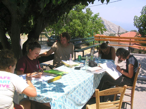 Fig. 10: Emily Graff, Sarah Ward, Jared Benton, Allisa Stoimenoff, and Clivia Zois working on their notebooks in the plateia of Ano Karyes.