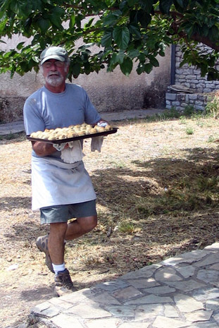 Fig. 20: Tommy D toting a tray of tasty treats.