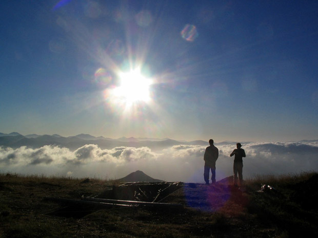 Fig. 21: Josh Gieske and Alexis Belis watch the morning sun over the temenos and Trench Y.