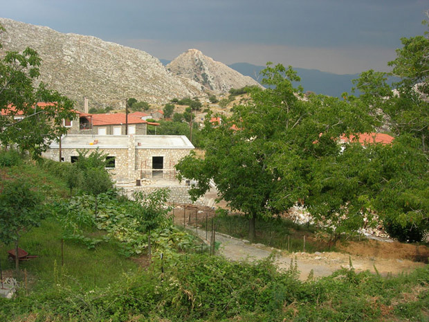 Fig. 4: View of Ano Karyes with new Lykaion Academy building in middleground.