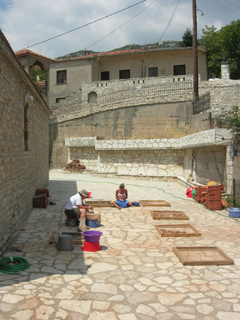 Fig. 17: Brittany Moore and Leslie Hammond washing pottery in the shadow of the church.