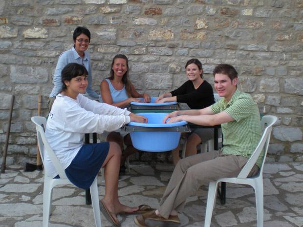 Fig. 6: Emily Kleinkauf, Teresa Moreno, Leslie Hammond, Sarah Linn, and Michael Tseng washing pottery.