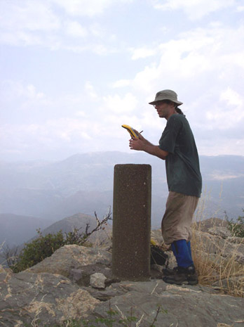 Fig. 6: Andrew Insua taking GPS coordinates at a geodetic marker.
