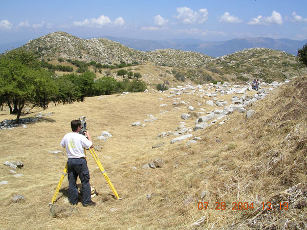 Fig. 7: Michael Tseng running the electronic total station during the architectural survey of the stoa.