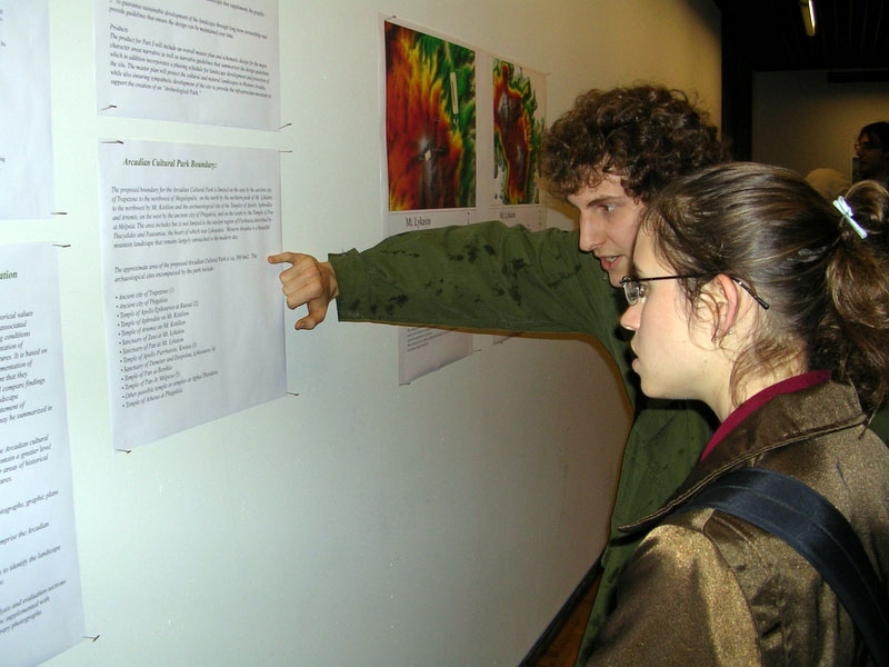 Fig. 8: Students examining the panels.