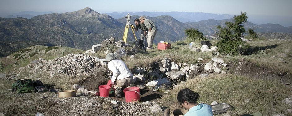 Students and scholars excavating and surveying on the Mt. Lykaion Excavation and Survey Project
